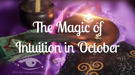Intuition - cauldron tarot cards and magic items on a purple blanket